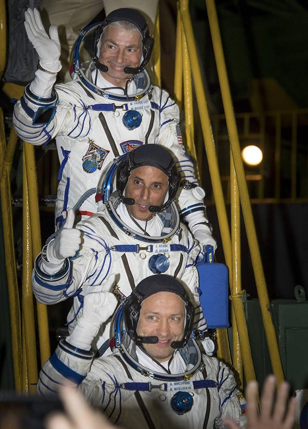 Expedition 53 flight engineer Mark Vande Hei of NASA (top), flight engineer Joe Acaba, KE5DAR, of NASA, and Soyuz Commander Alexander Misurkin of Roscosmos, (bottom). Photo courtesy of NASA.