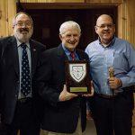 Presentation of the Hall of Fame Plaque to Neil Carleton: from left Richard Ferch VE3KI, Neil Carleton, VE3NCE and John Grow, VE2EQL